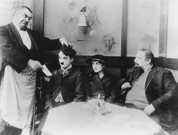 Eric Campbell, Charles Chaplin, Edna Purviance, Henry Bergman