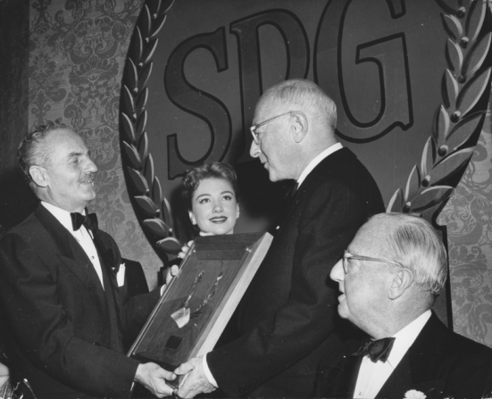 Darryl F. Zanuck, Anne Baxter, Jesse L. Lasky, Cecil B. Demille