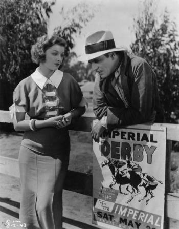 Myrna Loy, Warner Baxter