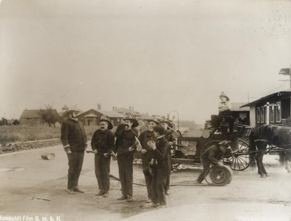 Eric Campbell, John Rand, Albert Austin, Charles Chaplin