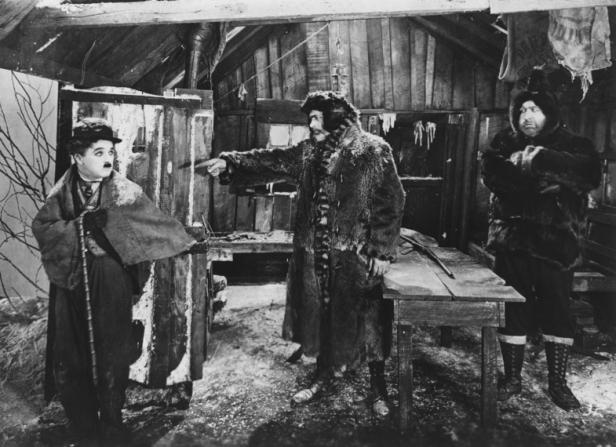 Charles Chaplin, Tom Murray, Mack Swain