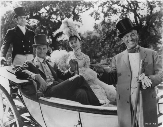 Louis Jourdan, Leslie Caron, Maurice Chevalier