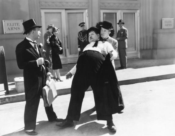 Stan Laurel, Oliver Hardy, James Finlayson