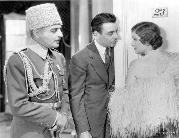 C. Henry Gordon, George Brent, Myrna Loy