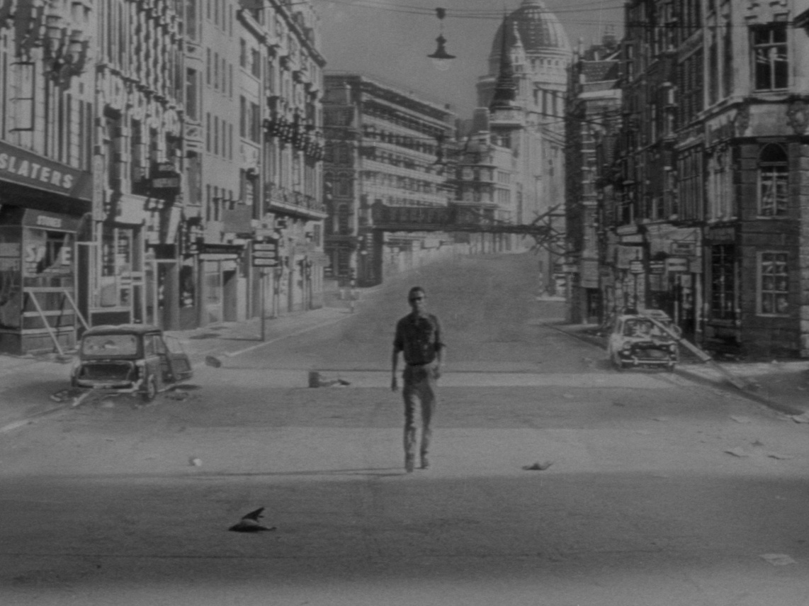 day-the-earth-caught-fire-the-1961-003-man-walking-deserted-street-1000x750.jpg