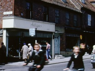 13 living colour snapshots of a typical English high street in the 1960s
