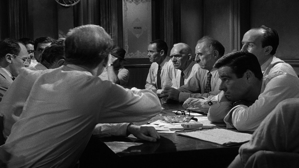 18. Compare this shot to Image 7. We still see all 12 men around the table, but the lower camera position and cramped framing now makes the room feel as if it has closed in on them.