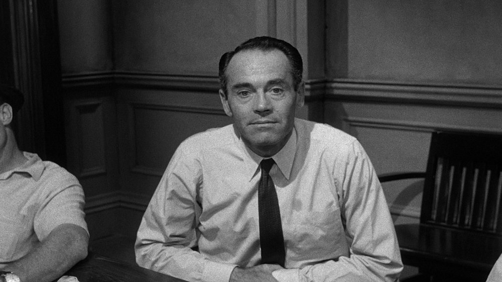 21. There's a simple but effective visual scheme to shots of individuals. The camera starts above eye-level, almost dispassionately observing them, then gradually moves to a more confrontational eye-level (and here Fonda almost looks as if he's appealing to the watching audience as much as his fellow jurors)…