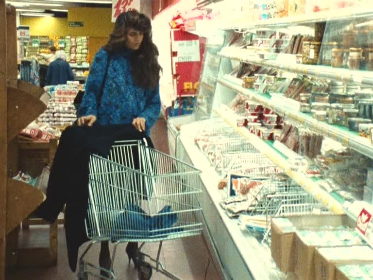 Keep your eyes peeled in Four Adventures of Reinette and Mirabelle (1987) for this extravagantly bouffed shoplifter, espied by Mirabelle (Jessica Forde) during a trip to the supermarché