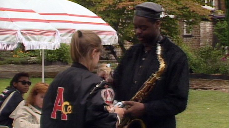 Courtney Pine signs an autograph for his newest fan in Silver Nemesis
