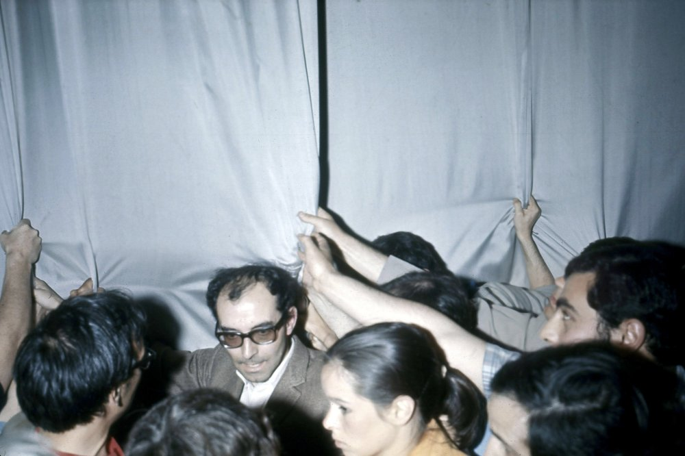 Jean-Luc Godard and Geraldine Chaplin in the middle of the 1968 protests at the Palais that shut down the festival that year.