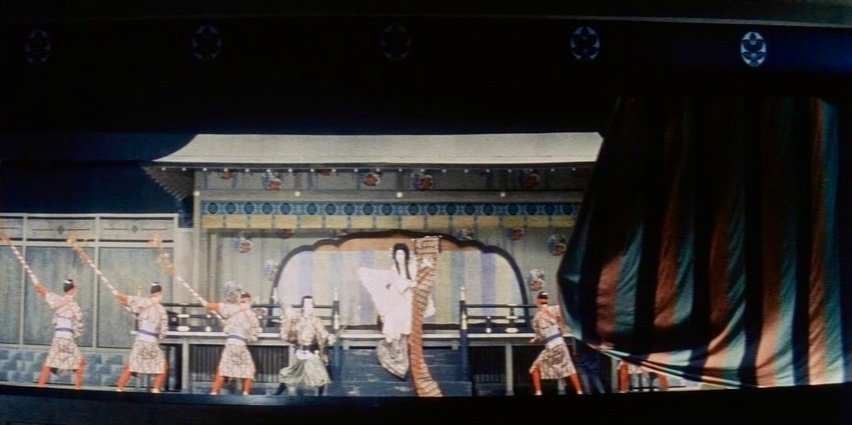 Some have attributed the Japanese mastery of the scope frame to its similarity with emaki narrative picture scrolls, read from right to left, and the elongated span of the Kabuki stage. This shot of the curtain sweeping across the stage to mark the end of Yukijono's performance echoes an earlier scene in which a right-to-left screen wipe effect performs the same function