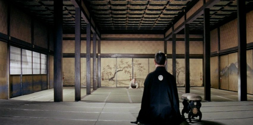 In many period films, traditional Japanese interior features such as tatami floor mats, shoji sliding panels and decorative fusuma screens are used to create striking grid-like compositions