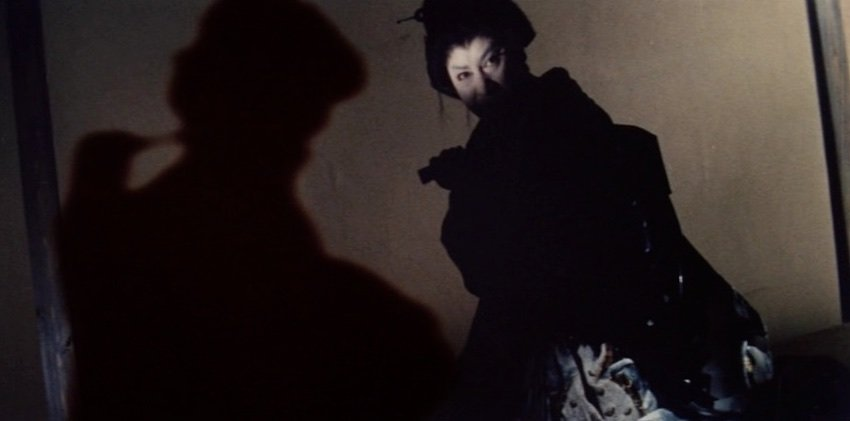 In this inventive flashback sequence, Yukinoji confronts the man who violated his mother, while her suicide is shown as a shadow performance beside him
