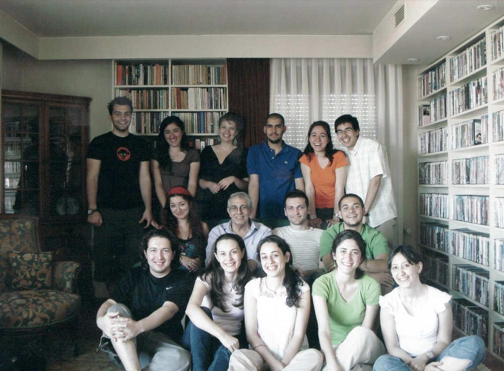 Mithat Alam (centre) with students in his living room