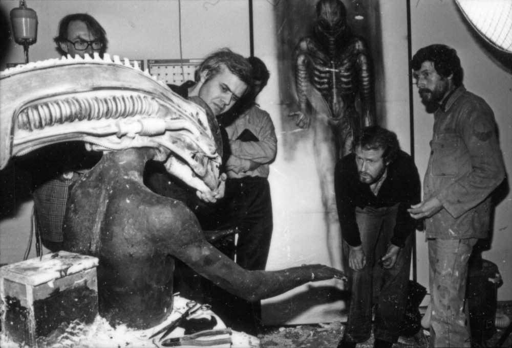 H.R Giger, Ridley Scott and crew inspect model during production for Alien (1979)