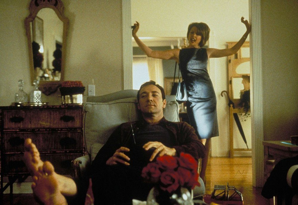 Bening as Carolyn Burnham behind Kevin Spacey as her husband Lester in American Beauty (1999)