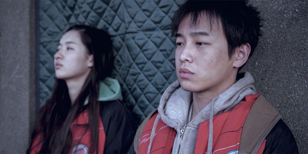 Wang Yuwen as Huang Ling and Peng Yuchang as Wei Bu in An Elephant Sitting Still