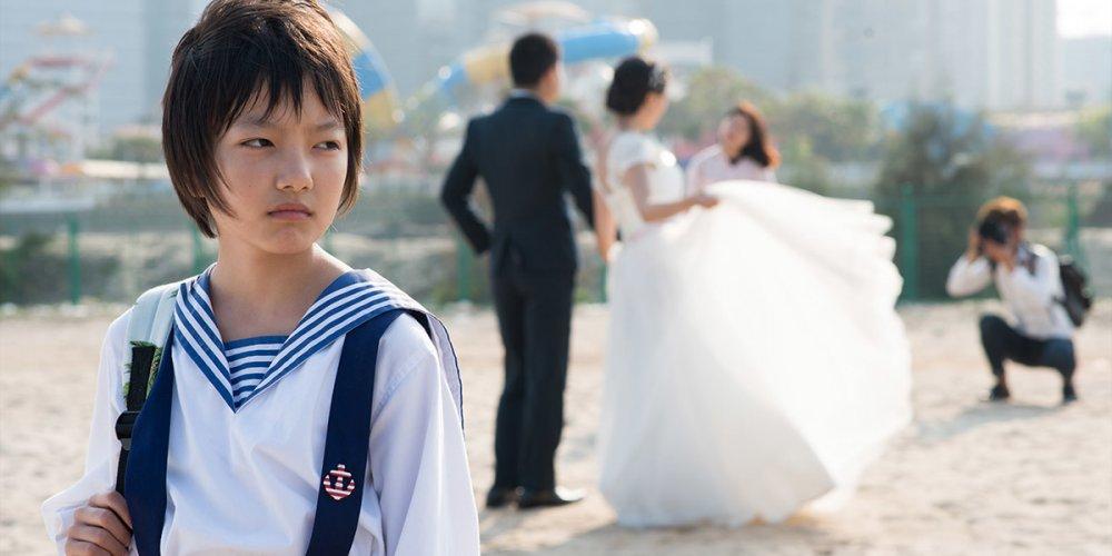 Zhou Meijun as Wen in Vivian Qu's Angels Wear White