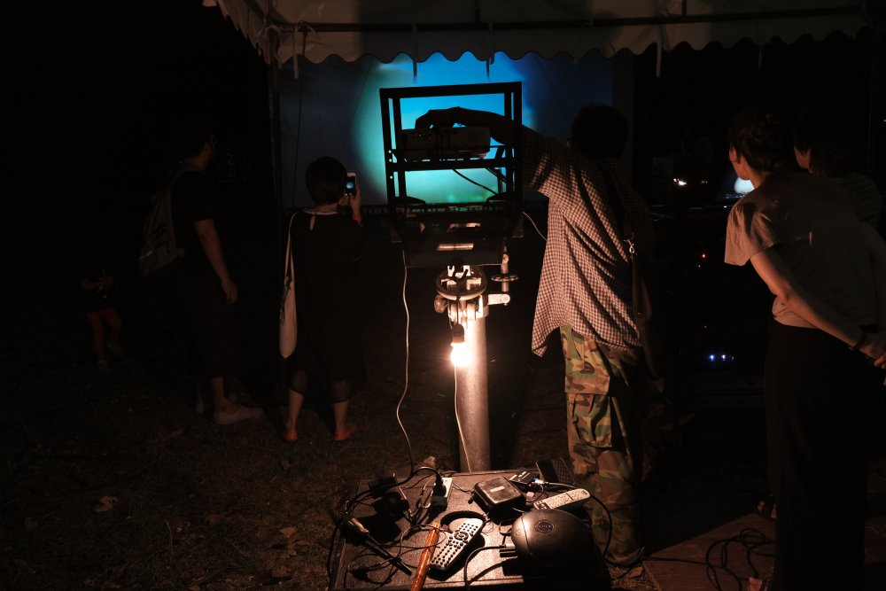 A projectionist at work at the Udon Thani Animistic Apparatus show