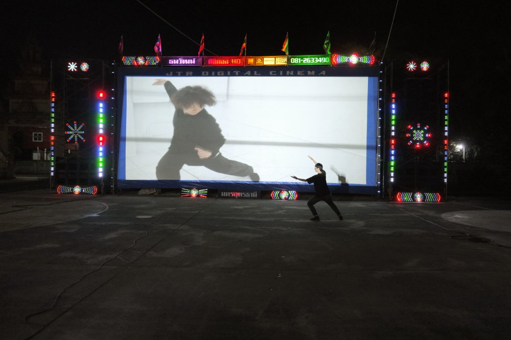An Animistic Apparatus ballet in front of a screen in Udon Thani, Thailand