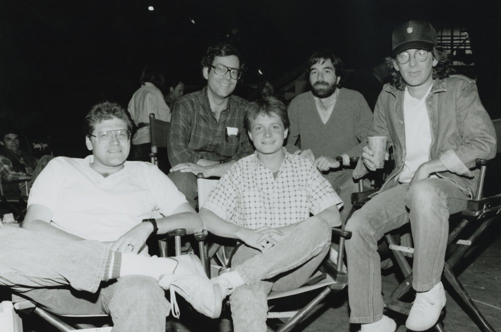 Robert Zemeckis, actor Michael J. Fox, producer Steven Spielberg and crew during production of Back to the Future (1985)