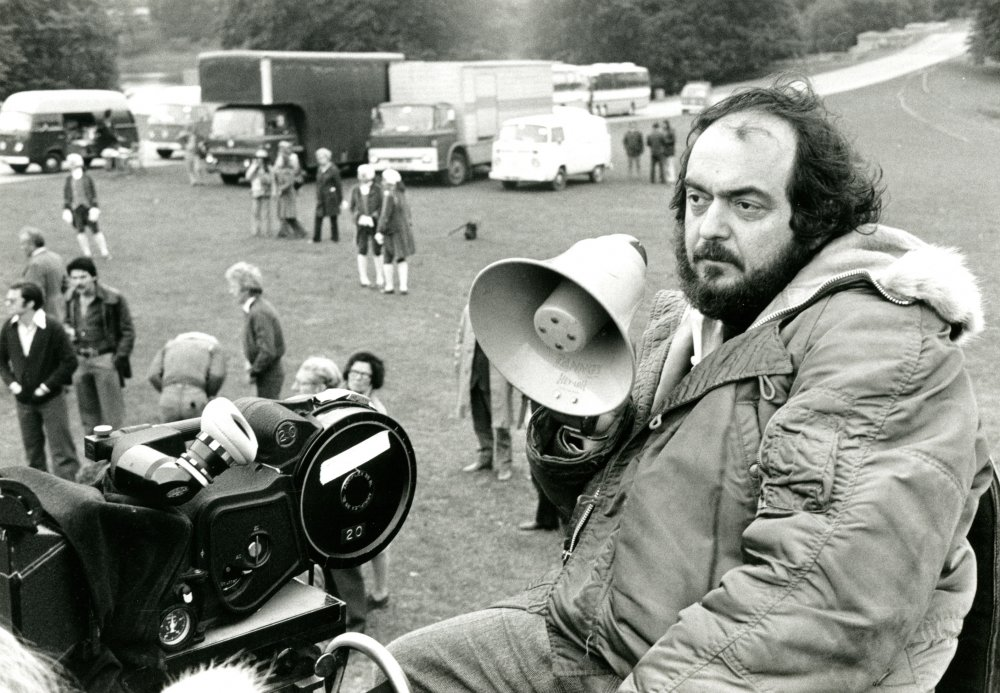Kubrick surveys the scene from atop the camera platform, as his crew and extras mingle below