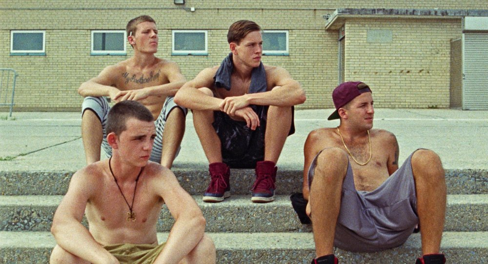 Harris Dickinson as Frankie (centre), surrounded by his posse in Eliza Hittman's Beach Rats