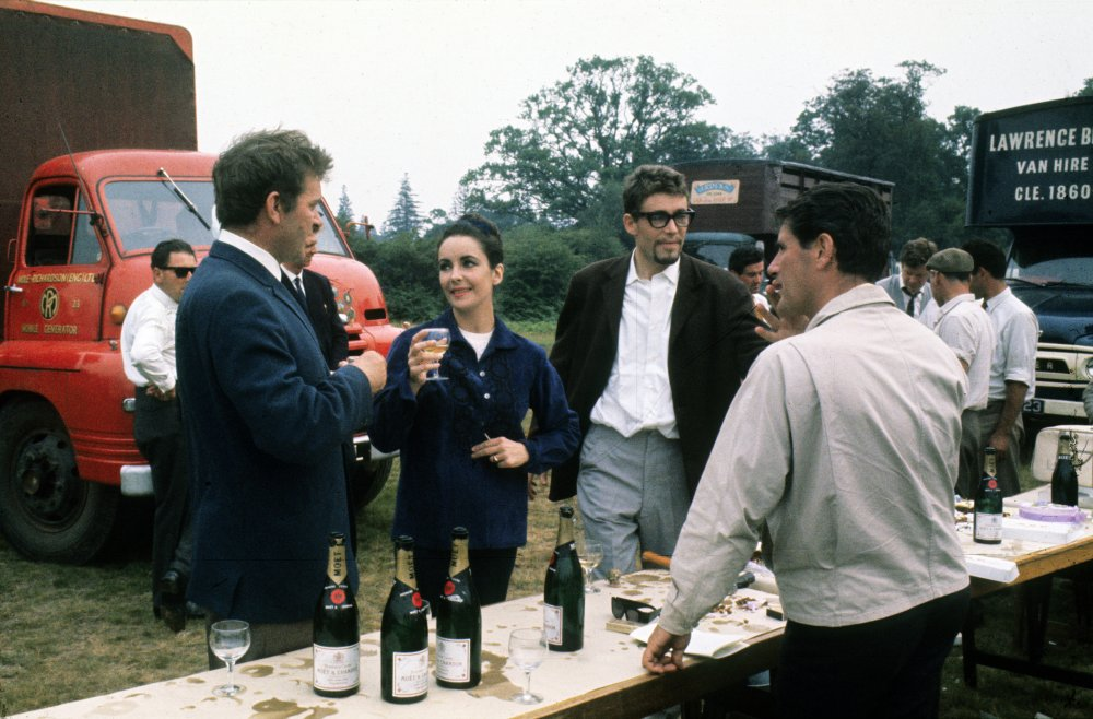 Drinking champagne with co-star Richard Burton and his wife Elizabeth Taylor on location for Becket