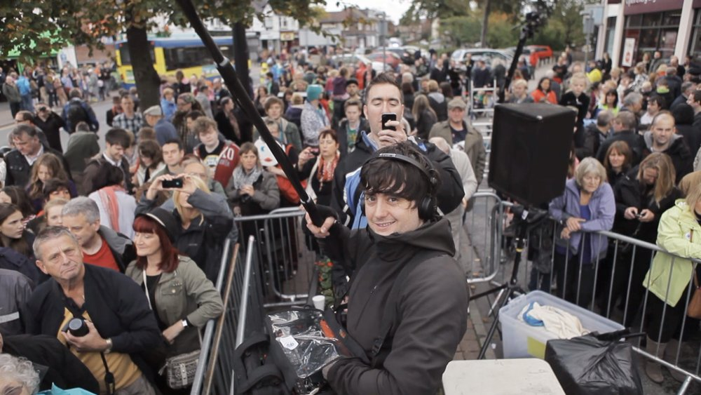 Steve Sullivan and sound recordist Dom Corbisiero swamped at the Frank Sidebottom statue unveiling
