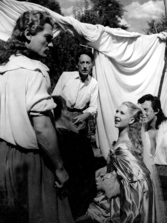 Jean Cocteau (centre) on the set of La Belle et la Bête (1946) with Jean Marais and Josette Day