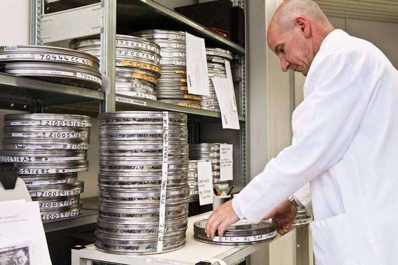 Inspecting film with Angelo Lucatello, Acqusitions and Access Conservation Specialist