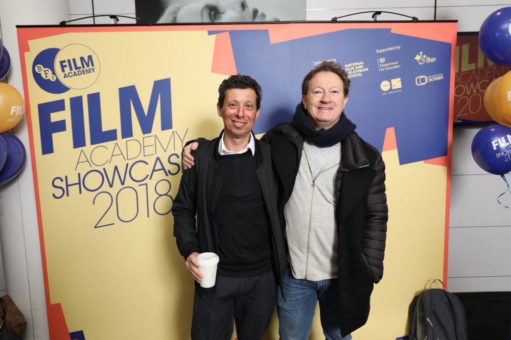Paul Trijbits, producer Saving Mr Banks, and Simon Beaufoy, screenwriter, Slumdog Millionaire, at the 2018 BFI Film Academy graduation
