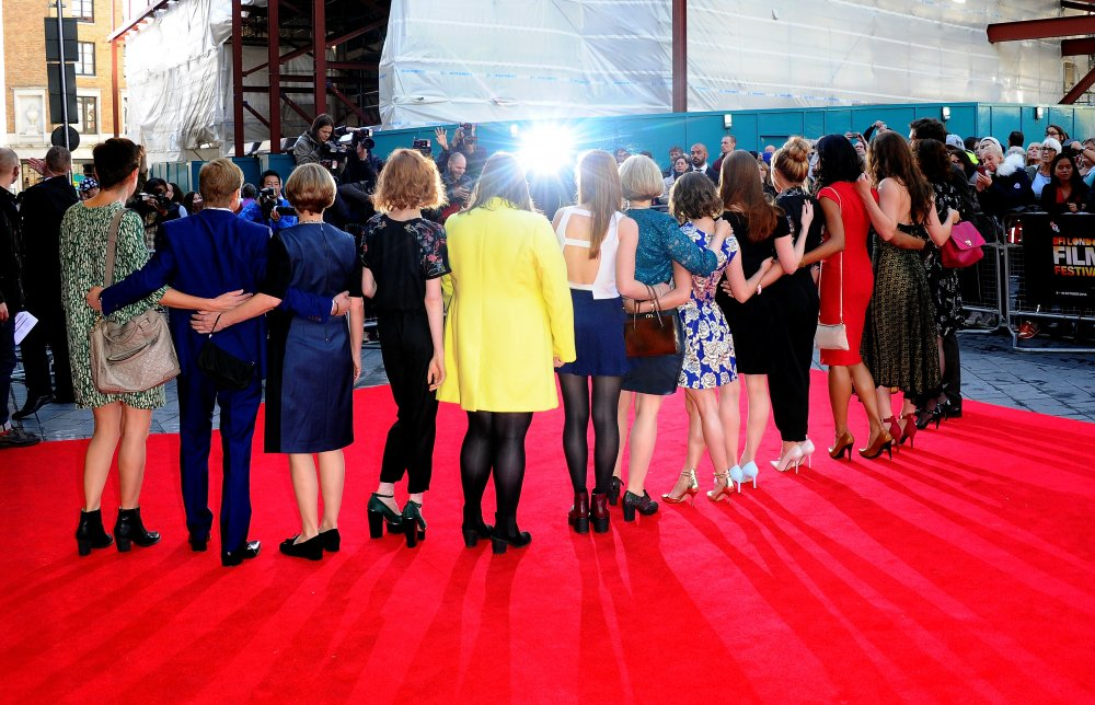 The cast and crew of The Falling on the red carpet at the 58th BFI London Film Festival