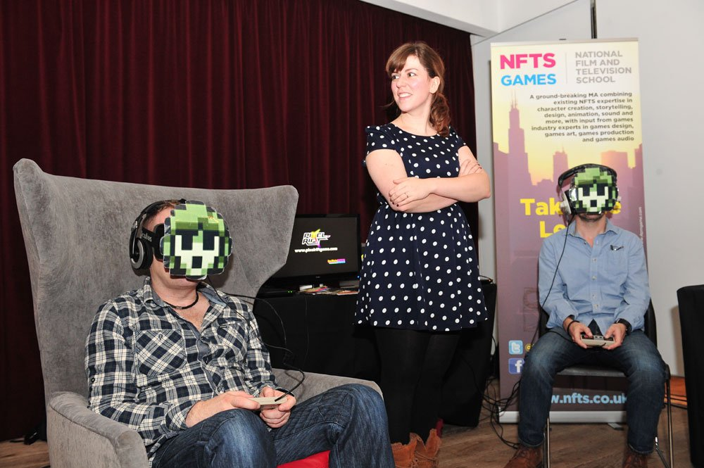 Attendees enjoy <strong>Pixel Rift </strong>on masked <strong>Oculus Rift</strong> headsets.
