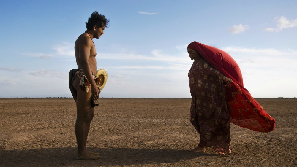 Jose Acosta as Rapayet and Carmiña Martínez as Ursula in Birds of Passage