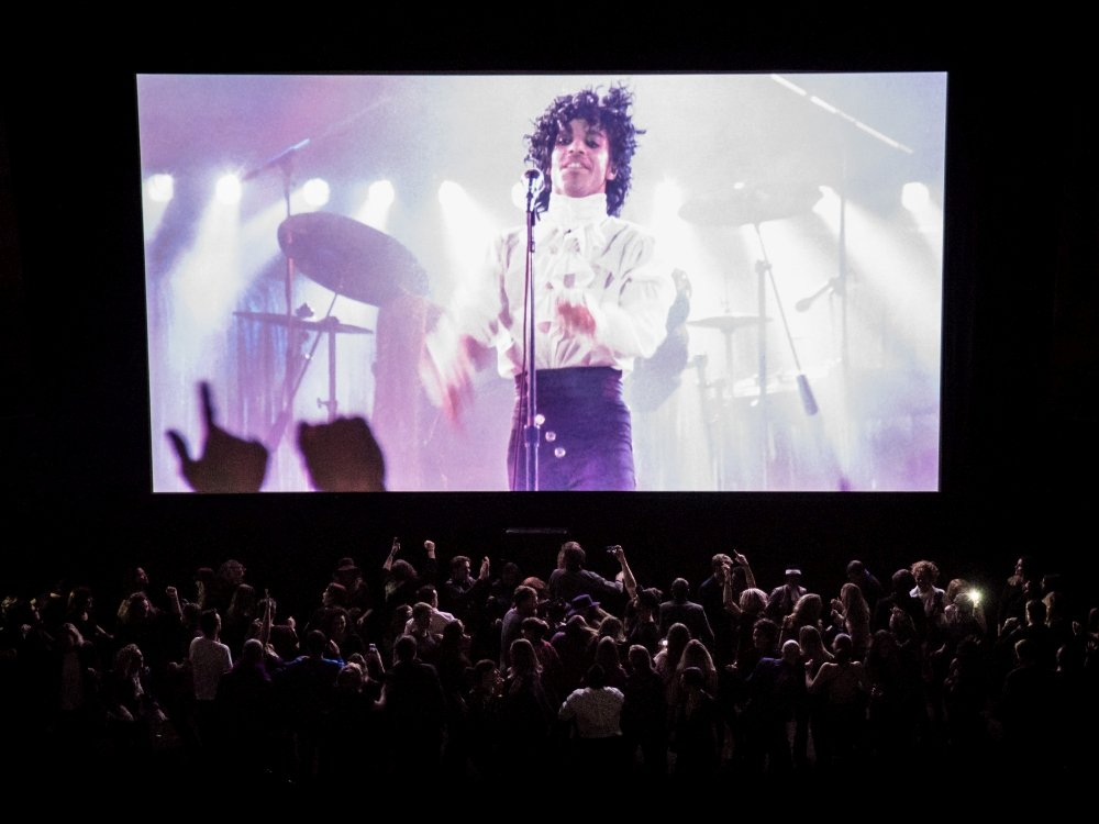 A packed house celebrates the life of Prince with a screening of the iconic Purple Rain (1984) at Colston Hall, Bristol