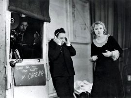 Director Alfred Hitchcock on set with lead actress Anny Ondra directing the now better-known sound version of Blackmail
