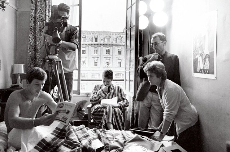 Godard (right) with cast and crew filming in the Hotel de Suede