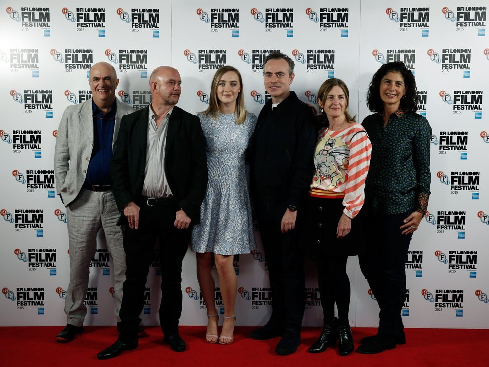 Novelist Colm Tóibín, screenwriter Nick Hornby, actor Saoirse Ronan, director John Crowley and producers Finola Dwyer and Amanda Posey attend the Brooklyn photocall during the BFI London Film Festival