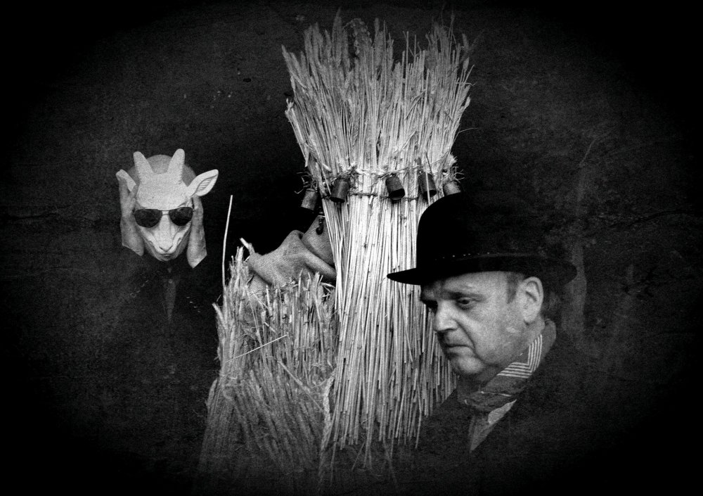 A still from Andrew Kötting's installation By Our Selves, with Iain Sinclair (left), Toby Jones (right) and the artist as straw bear (centre)