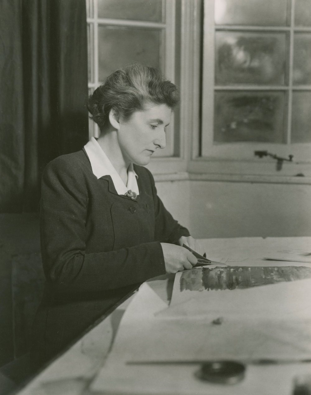 <strong>Carmen Dillon</strong>, art director, at work in her studio in 1949. Dillon is acknowledged as the first female art director to work at a British film studio.