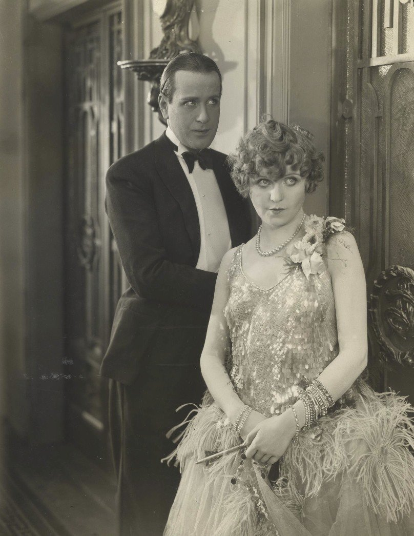 Production still from Champagne – Jean Bradin with Betty Balfour wearing the kind of lavish 1920s costume that looks so good in black and white film.
