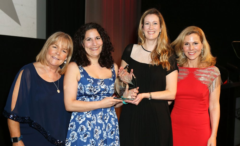The winners collecting on behalf of St John Ambulance with Linda Robson (left), who presented the award, and host Sally Phillips (right)
