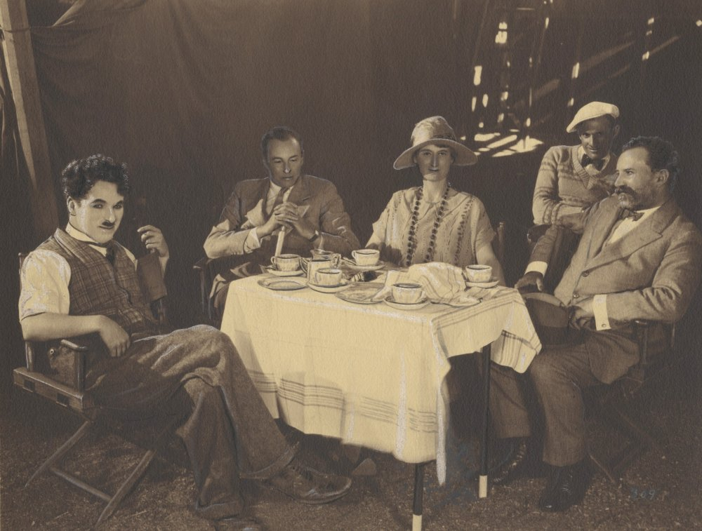 Chaplin on the set of The Circus, entertaining Sir Henry and Lady Wood for afternoon tea, c.1928, photographer unknown