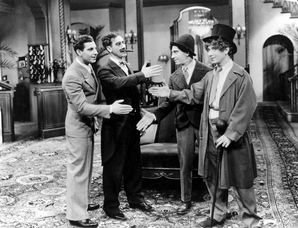 Zeppo (left) trying to get a hand in edgeways with Groucho, Chico and Harpo in the Brothers' screen debut, The Cocoanuts (1929)