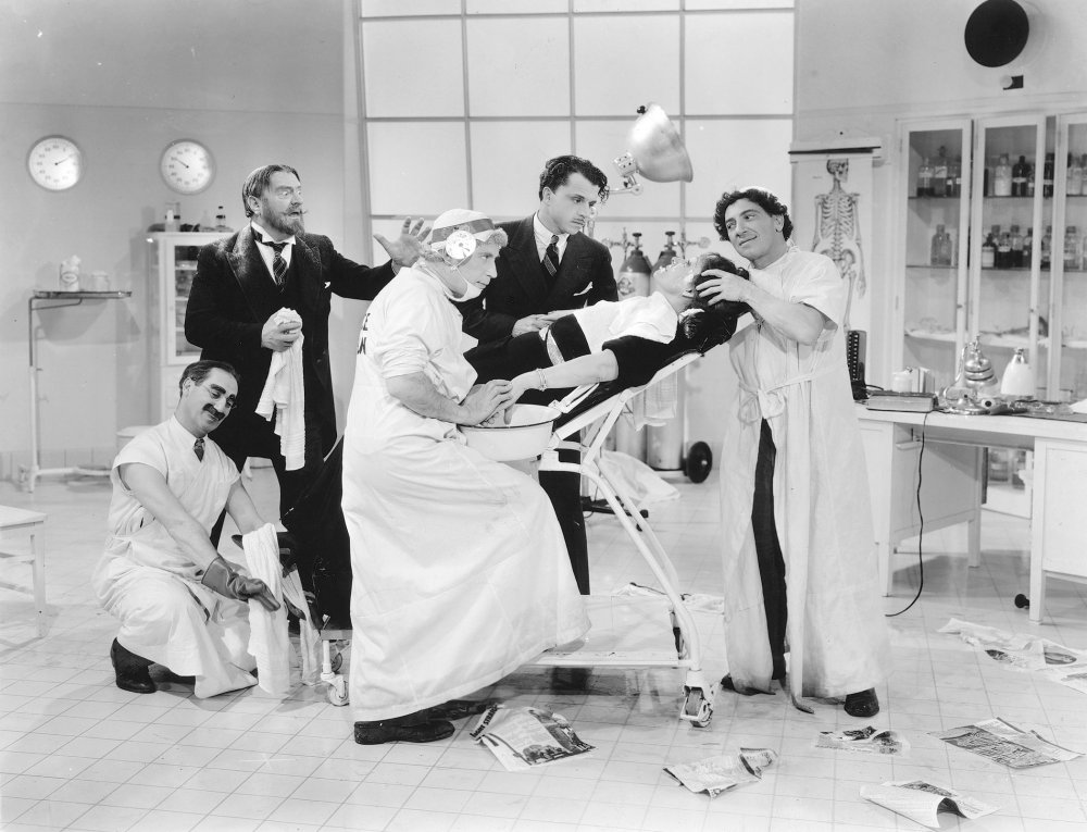 Sig Ruman's Dr Leopold Steinberg (upper left) protests best medical practice in Groucho's surgery in A Day at the Races (1937)