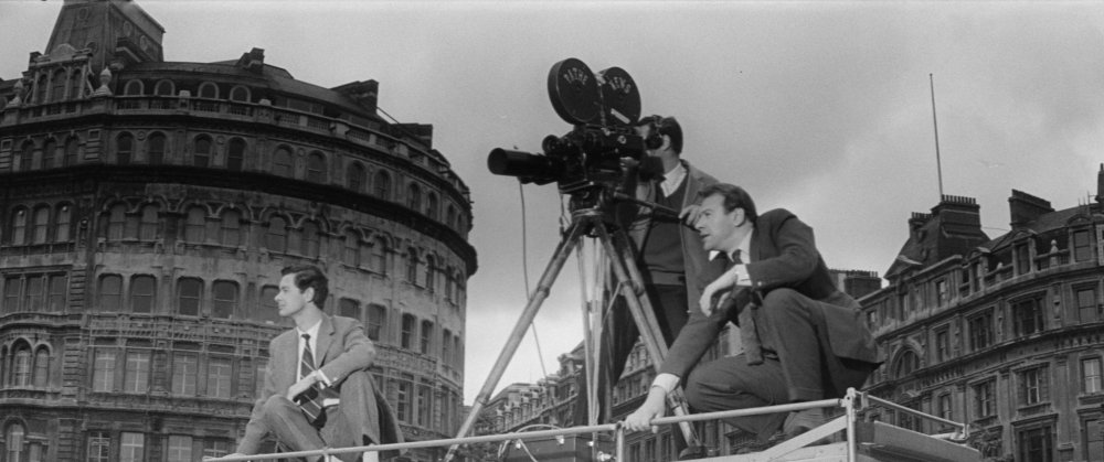 A news crew films a demonstration in Trafalgar Square