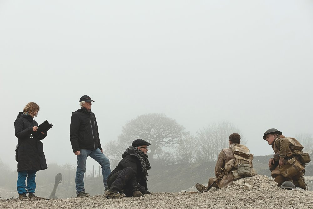 Roger Deakins (standing) with director Sam Mendes (seated, in flat cap) on the set of World War I drama 1917, which earned the cinematographer his second Oscar from 15 Academy Award nominations