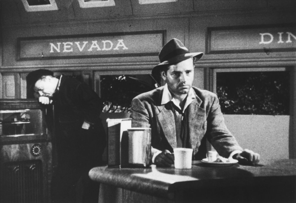 Tom Neal's self-crossed antihero Al Roberts in Edgar G. Ulmer's Detour (1945)